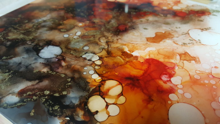 Details from an alcohol ink painting in red