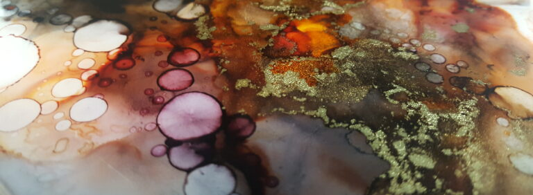 Details from an alcohol ink painting in red.