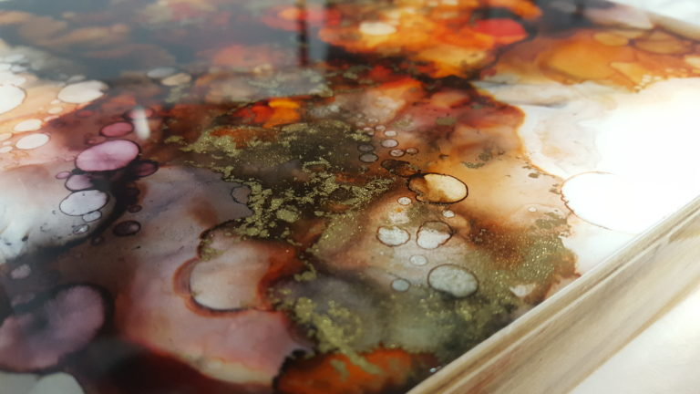 details of an alcohol ink painting in red