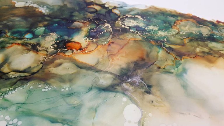 Alcohol ink details from larger painting in green and orange